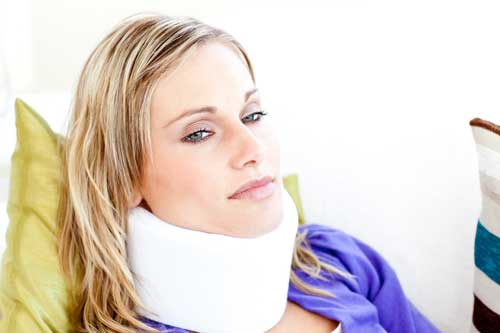Women who is suffering from a car injury which has been paralyzed.