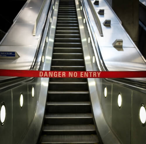 An escalator which has been closed due to someone getting hurt on it.