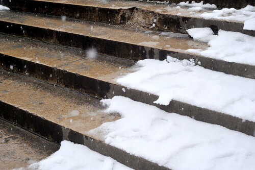 Steps in Denver cover with snow and ice, which the store owner neglected to remove.