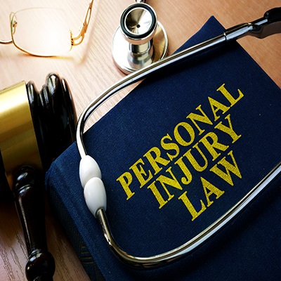 blue personal injury law book & court gavel